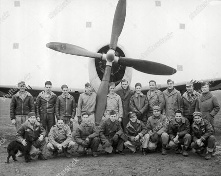 The large number of Minnesota boys serving in the ground crew at a fighter plane base in England, crew to such proportion that they have called themselves the Minnesota Air Force. Some of them are grounded under one of their planes, left to right, front row, are: Pfc. Kenneth Christopher, Minneapolis; T/Sergeant Clarence H. Koskela, Minneapolis; Sergeant Henry C. Louhela, Floodwood, Pfc. Carroll H. Burnevik, Minneapolis; S/Sergeant Donald O. Burnevik, South, Minneapolis; Sergeant Paul Janousek, Hutchinson; S/Sergeant Earl N. Sugars, Duluth; S/Sergeant Edward B. Fonnier, Shakopee. Back row, left to right are: T/Sergeant Osmo E. Tahja, Floodwood; Corporal Milton H. Franke, Minneapolis; S/Sergeant Ernest Magnuson, Sergeant Donald Detul, Excelsior; S/Sergeant Robert J. Fitzgerald, Duluth; S/Sergeant Rodolph V. Ellingsen, Minneapolis; Pfc. J.M. Anderson, So., Minneapolis; S/Sergeant Arthur A. Roloff, Winona; Sergeant Arthur F. Watson, Wilkinson; S/Sergeant Lloyd W. Johnson, Minneapolis