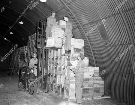 Stock Picture of Loading blood plasma at a quartermaster depot somewhere in England, from left to right are: Corporal Glenn H. Yotten, Cape Girardeau, Missouri; Sergeant Herschel G. Rawlins, Doniphan, Missouri; Pfc. Delmar L. Price, St. Louis, Missouri, and Sergeant John F. Galvin, St. Louis, Missouri
