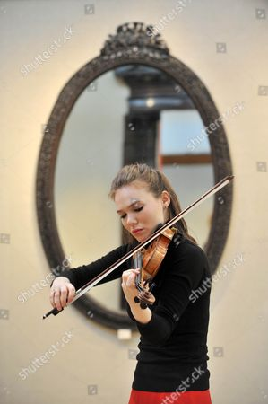 Tamsin Waley-Cohen of the Royal Philharmonic Orchestra gives a performance with 'The Penny' Stradivarius violin.