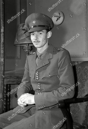 Crown Prince Jean of Luxembourg, a 1st Lieutenant in the Irish Guards, poses for a portrait in London, . His family are waiting for the first opportunity to return to Luxembourg