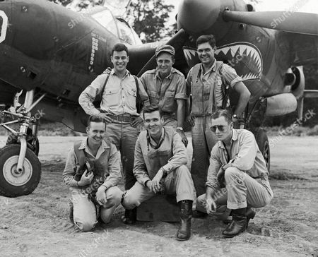 Group of American fighter pilots based on New Guinea, up to the middle of May accounted for a total of 36 Japanese planes on . They are front row (left to right) Capt. Charles P. Sullivan, Eureka, Ill., four planes; Capt. Thomas J. Lynch, Casasauqua, Penn., 10 planes; First Lieut. Kenneth C. Sparks, Blackwell, Okla., nine planes. Standing (left to right) are First Lieut. Richard C. Suehr, Pittsburgh, Pa., five planes; Second Lieut. John H. Lane, Bakersfield, Calif., four planes; and First Lieut. Stanley O. Andrews, St. Petersburg, Fla., four planes