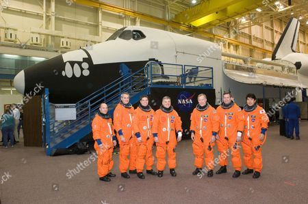 The STS-123 crewmembers take a break from a training session in the Space Vehicle Mockup Facility at the Johnson Space Center in Houston - From the left are astronauts Garrett E. Reisman, Richard M. Linnehan and Robert L. Behnken, all mission specialists; Gregory H. Johnson, pilot; Dominic L. Gorie, commander; Michael J. Foreman and Japan Aerospace Exploration Agency's (JAXA) Takao Doi