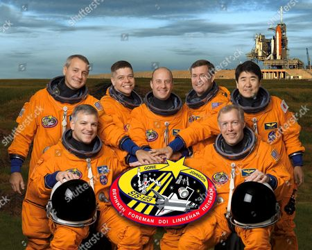 The STS-123 crew portrait. From the right (front row) are astronauts Dominic L. Gorie, commander; and Gregory H. Johnson, pilot. From the left (back row) are astronauts Richard M. Linnehan, Robert L. Behnken, Garrett E. Reisman, Michael J. Foreman and Japan Aerospace Exploration Agency's (JAXA) Takao Doi