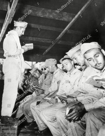 A service on Yom Kippur, the Jewish Day of Atonement, is conducted by Chaplain Capt. Elliot Davis of Tulsa, Okla., for soldiers of the Jewish faith on New Georgia Island in the Southwest Pacific on