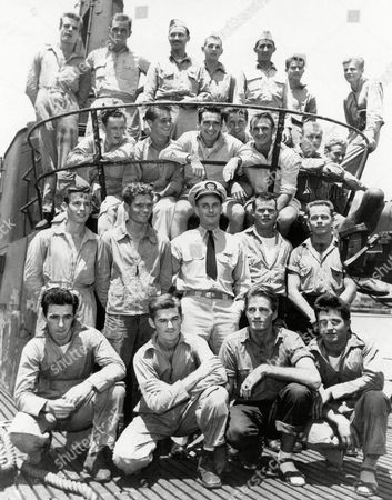 These US Navy carrier-based fliers, shown, were among the 22 rescued from the Truk Lagoon by the American submarine Tang during the American attack of the Japanese stronghold on April 29-30. The submarine, under the command of Comm. Richard H. O'Kane of San Rafael, Calif., braved the fire from shore batteries to make the rescues. Shown left to right are (bottom row): Harry B. Gemmell, aviation radioman 2nd/C of Philadelphia, Pa.; Joseph Hranek, aviation radioman, 2nd/C. of Endicott, N.Y.; James L. Livingston, aviation radioman, 1st/C.of Los Angeles; Joseph Daniel Gendron, aviation machinist's mate, 2nd/C., of Oakland, R.I. Shown in second row, left to right, are Robert William Gruebel, aviation machinist's mate, 1st/C. of Memphis, Tenn.; Robert Edwin Hill, aviation radioman 2nd/C. of Houston, Tex.; Lt. Comm. Richard H. USN; H.A. Thompson, aviation ordnance man, 2nd/C. of San Bernardino, Calif.; Aubrey James Gill, aviation radioman, 2nd/C of Compton, Calif. In third row, left to right, are Ensign Carroll L. Farrell of Ada, Okla.; Lt. (J.G.) James G. Cole,of Killeen, Tex.; Lt. John Joseph Dowdle, Jr. of Wilmette, Ill.; Lt. (J.G.) J.A. Burns of Wynnewood, PA.; Lt. (J.G.) Robert T. Barbor of Rockville Center, L.I., N.Y.; Lt. Harry Edwin Hill of Virginia, Minn.; Lt. (J.G.) Scott Scammell 2nd, of Yardley, PA. In the top row, left to right are d/C., of Portland, Ore.; Lt. (J.G.) Robert F. Kanze, of Freehold, N.J.; Lt. Donald Kirkpatrick, Jr. of Evanston, Ill.; James J. Lenahan, aviation radioman, 2nd/C.of Westfield, N.J.; Comm. A.R. Matter, USN, of Butte, Mont.; Richard L. Bentley, aviation ordnance man, 2nd/C.of Los Angeles, Calif.; Lt. Robert S. Nelson of Great Falls, Mont