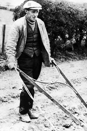 Stock Image of David McLean, the Scottish ploughman who found Rudolf Hess, after the Nazi leader's dramatic descent on Scottish soil in his parachute, and challenged him with a hay-fork, thinking him to be just another Nazi airman, baling out. He is here seen at his plough, carrying on with his daily work as usual after finding himself a front-page celebrity