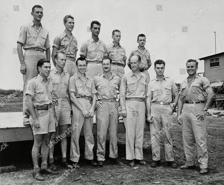Crew members of the Enola Gray, B-29 Superfortress from which the first atomic bomb was dropped on Hiroshima are shown, from left to right, front row: 1st Lt. Jacob Beser, 2nd Lt. Norris R. Jeppson Capt. Theodore J. Van Kirk; Maj. Thomas W. Ferebee, Capt. William S. Parsons, Col. Paul W. Tibbets Jr., Capt. Robert A. Lewis. Back row, left to right: Sgt. Robert R. Shumard, Pfc., Richard H. Nelson, Sgt. Joe A. Stiborn, Sgt. Wyatt E. Duzenbury, Sgt. George R. Caron