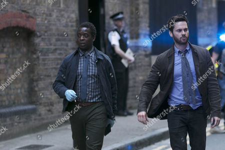 Stock Image of Kobna Holdbrooke-Smith (as Dave Pulford) and Tom Riley (as DI Will Wagstaffe)