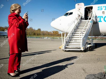Stock Picture of Hillary Clinton Democratic presidential candidate Hillary Clinton FaceTimes with her granddaughter Charlotte Clinton Mezvinsky, as she arrives to board her campaign plane at Westchester County Airport in White Plains, N.Y., to travel to Pittsburgh