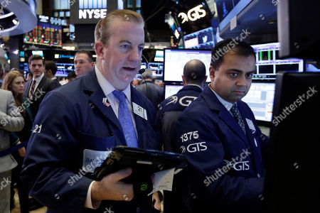 Stock Picture of James Doherty, Dilip Patel Trader James Doherty, left, and specialist Dilip Patel work on the floor of the New York Stock Exchange, . Stocks are opening sharply higher on Wall Street after the F.B.I. said newly discovered emails didn't warrant any action against presidential candidate Hillary Clinton