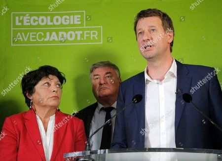 Stock Photo of Green party presidential candidate Yannick Jadot, right, speaks to the media as he Member of the European Parliament Michele Rivasi stands next to him during a media conference in Paris, . Jadot won the presidential primary of the Green party and will run for the 2017 French presidential election