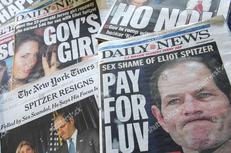 American newspaper headlines covering the connection between New York Governor Eliot Spitzer and a prostitute named Ashley Alexandra Dupre, a 22-year-old aspiring singer