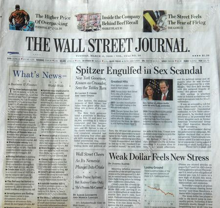 Sensational headline on the cover of the Wall Street Journal covering the connection between New York Governor Eliot Spitzer and a prostitute named Ashley Alexandra Dupre, a 22-year-old aspiring singer
