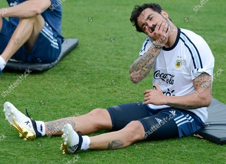 Argentina's Ezequiel Lavezzi stretches during a training session in Belo Horizonte, Brazil, . Argentina will face Brazil in a 2018 World Cup qualifying soccer match on Thursday