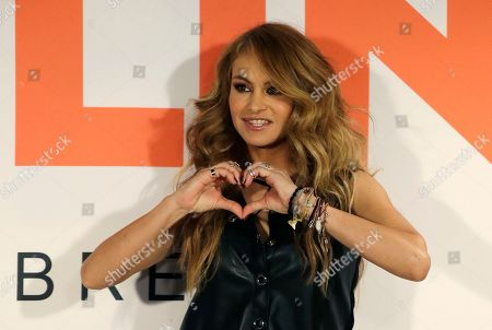 Paulina Rubio Mexican singer Paulina Rubio forms a heart with her hands as she poses for photographers before the start of a press conference in Mexico City