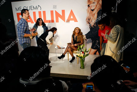 Paulina Rubio Mexican singer Paulina Rubio is surrounded by assistants as she sits for the start of a press conference in Mexico City