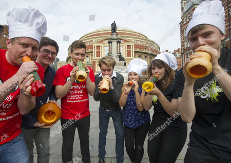 Stock Picture of The Edible Orchestra Warms Up Ahead Of 'ratatouille In Concert'. Members Of The Royal Philharmonic Concert Orchestra Students At The Royal College Of Music And Musicians Of The London Vegetable Orchestra Are Pictured Playing Instruments Made Out Of Vegetables. Pictured: (l-r) Bill Cooper Tom Lee Richard Ward Paul Cott Claire Graham Kirsty Loosemore And Nicolas Kent Play Their Instruments Made Out Of Vegetables.