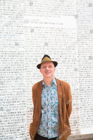 Artist Bob and Roberta Smith photographed in front of his artwork 'Interview with David Nott by Eddie Mair'