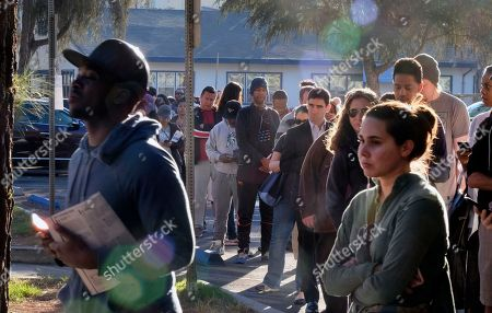 Voters wait at the North Hollywood Amelia Earhart Regional Library in Los Angeles on . Long lines were reported at polling places across the city as voters hoped to cast their ballots before heading to work