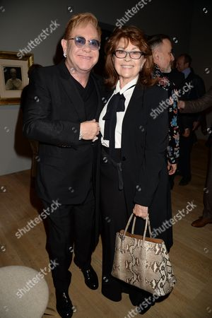 Stock Image of Sir Elton John and Nanette Newman