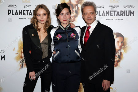 "Actress Lily-Rose Depp, left, director Rebecca Zlotowski, center, and actor Emmanuel Salinger pose during the premiere of ""Planetarium"", in Paris"