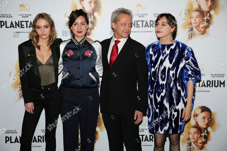"From left, actress Lily-Rose Depp, director Rebecca Zlotowski, actor Emmanuel Salinger and actress Amira Casar pose during the premiere of ""Planetarium"", in Paris"
