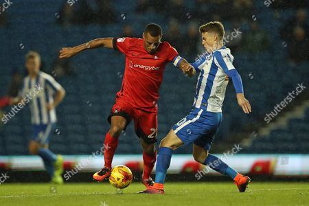 Leyton Orient striker Jay Simpson (27) and Brighton & Hove Albion striker Solomon March (20) during the EFL Trophy Southern Group G match between U23 Brighton and Hove Albion and Leyton Orient at the American Express Community Stadium, Brighton and Hove