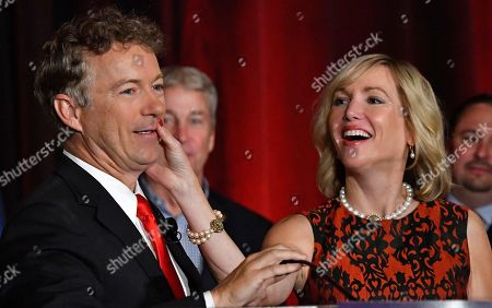 Rand Paul, Kelley Paul Kelley Paul, wife of Sen. Rand Paul, R-Ky. wipes lipstick from his face following their celebratory kiss at his victory celebration, in Louisville Ky