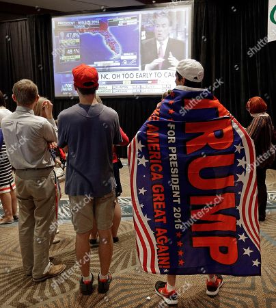 Stock Picture of William Murray Williams Murray, of Pittsburgh, Pa., right, wears a Trump banner as he watches election returns at a rally for North Carolina Gov. Pat McCrory in Raleigh, N.C