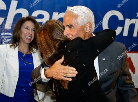 Charlie Crist, Carole Crist, Elizabeth Hyden Former Florida Gov. Charlie Crist hugs his wife Carole after being elected to the U.S. House of Representatives, in St. Pete Beach, Fla. Crist defeated his Republican opponent David Jolly. Looking on is Crist's sister Elizabeth Hyden