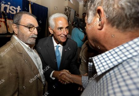 Charlie Crist Former Florida Gov. Charlie Crist, center, shakes hands with supporters after being elected to the U.S. House of Representatives, in St. Pete Beach, Fla. Crist defeated his Republican opponent David Jolly