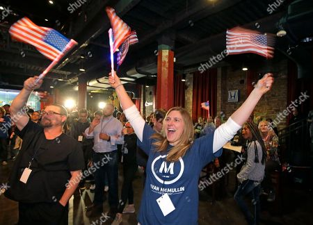 Robin Ball, right, shows her support for Independent presidential candidate Evan McMullin during a election night watch party, in Salt Lake City
