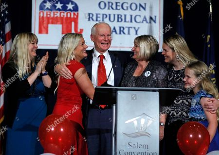 Dennis Richardson, Valerie Harmon, Jennifer Vranes, Cathy Richardson, Rachel Whoolery, Samara Whoolery Dennis Richardson, center, Oregon Republican Secretary of State candidate, is surrounded by his family, daughters Valerie Harmon, left, Jennifer Vranes, second from left, his wife Cathy, third from right, daughter Rachel Whoolery, second from right, and granddaugher Samara Whoolery, right, at an election night event at the Salem Convention Center in Salem, Ore