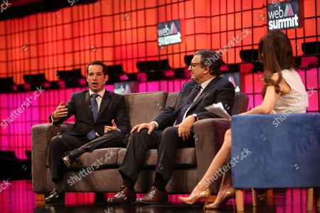 Stock Photo of Daniel Sacks of AppDirect (L) speaks as Former European Commission president and actual Non-executive Chairman of Goldman Sachs Jose Manuel Barroso (C) and Karen Tso of CNBC (R) listen