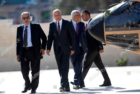 Arab League Secretary-General Ahmed Aboul Gheit, center, and former Arab League Secretary-General Amr Moussa, left, arrive to meet with Palestinian President Mahmoud Abbas in the West Bank city of Ramallah