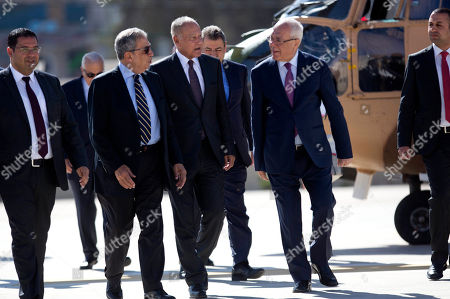 Stock Picture of Arab League Secretary-General Ahmed Aboul Gheit, center, and former Arab League Secretary-General Amr Moussa, left, with chief Palestinian negotiator Saeb Erekat, right, arrive to meet with Palestinian President Mahmoud Abbas in the West Bank city of Ramallah