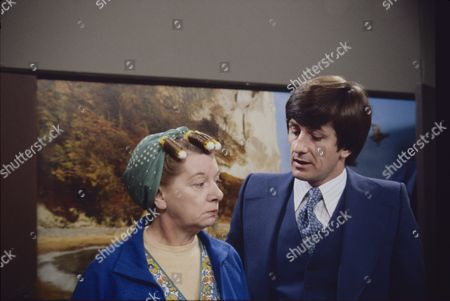 Stock Image of Jean Alexander (as Hilda Ogden) and Norman Gregory (as Detective Sergeant Thornton)
