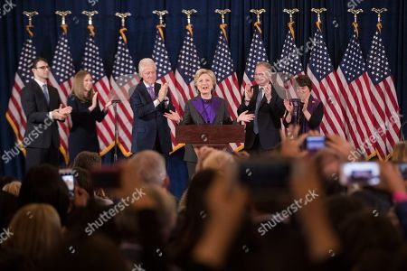 Democratic presidential candidate Hillary Clinton, accompanied by, from left, son-in-law Marc Mezvinsky, daughter Chelsea Clinton, husband, former President Bill Clinton, vice presidential candidate, Sen. Tim Kaine, D-Va., and his wife Anne Holton, speaks in New York, . Clinton conceded the presidency to Donald Trump in a phone call early Wednesday morning, a stunning end to a campaign that appeared poised right up until Election Day to make her the first woman elected U.S. president