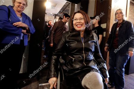Stock Image of Democratic U.S. Rep. Tammy Duckworth is greeted by supporters before a private luncheon, in Springfield, Ill. Duckworth unseated Republican U.S. Sen. Mark Kirk in Tuesday's election