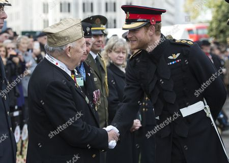 Prince Harry meets Maurice Jones (87) who has been attending this service for 66 years.