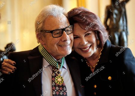 Argentina's composer Lalo Schifrin poses with his wife Donna after being awarded Commandeur in the Arts and Letters order by French Culture and Communication minister Audrey Azoulay in Paris, Thursady