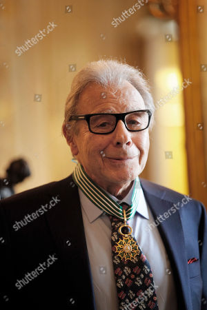 Argentina's composer Lalo Schifrin poses after being awarded Commandeur in the Arts and Letters order by French Culture and Communication minister Audrey Azoulay in Paris, Thursady