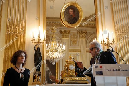 Argentina's composer Lalo Schifrin, right, delivers his speech after being awarded Commandeur in the Arts and Letters order by French Culture and Communication minister Audrey Azoulay in Paris, Thursady