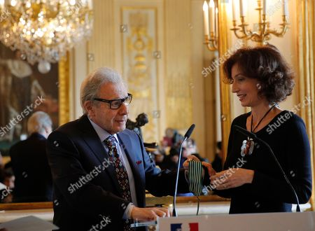 Argentina's composer Lalo Schifrin, left, is awarded Commandeur in the Arts and Letters order by French Culture and Communication minister Audrey Azoulay in Paris, Thursady