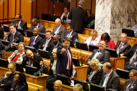South African DA, Democratic Alliance party member, David Maynier, center, points at opposition party members before a motion to remove South African President Jacob Zuma as President at Parliament in Cape Town, South Africa, . South Africa's parliament is debating a motion to remove President Jacob Zuma because of a series of scandals, including possible government corruption linked to the president and some associates