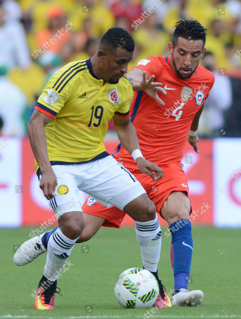 Farid Diaz, Mauricio Isla Colombia's Farid Diaz, left, and Chile's Mauricio Isla battle for the ball in a 2018 World Cup qualifying soccer match in Barranquilla, Colombia
