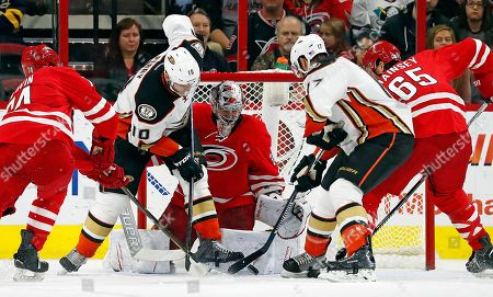 Jaccob Slavin, Corey Perry, Cam Ward, Ryan Kesler, Ron Hainsey Anaheim Ducks' Corey Perry (10) and Ryan Kesler (17) battle for the puck in front of Carolina Hurricanes goalie Cam Ward (30) with Hurricanes' Jaccob Slavin (74) and Ron Hainsey (65) providing support during the second period of an NHL hockey game, in Raleigh, N.C