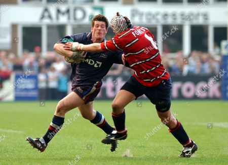 Andy Titterell (Gloucester) tackled by James Forrester (Gloucester) Sale Sharks v Gloucester 18/04/2003 Great Britain Sale