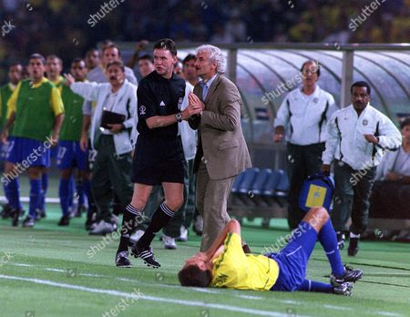 Stock Photo of Hugh Dallas the fourth officail holds on to Rudi Voller the Germany Manager as Edmilson (Brazil) lies on the floor injured Brazil v Germany The World Cup Final Yokohama Japan 30/6/02 Japan Yokohama
