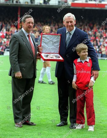Peter Hill Wood the Arsenal Chairman gives Bob Wilson an award for his services to Arsenal Football Club Arsenal v Everton FA Premiership 11/5/02 Great Britain London